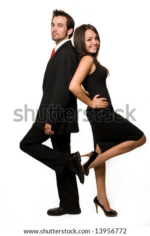 Full body of an attractive brunette woman standing with back up against an attractive man in business suit over white
