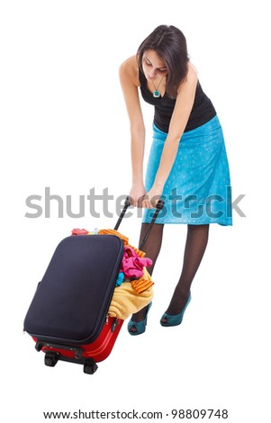Full body of an attractive woman dragging suitcase on white - stock photo