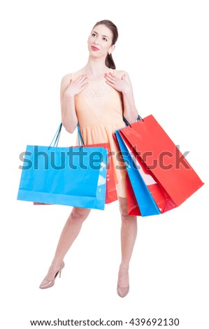 Full body of beautiful lady standing and being content with shopping bags isolated on white background with copy text space