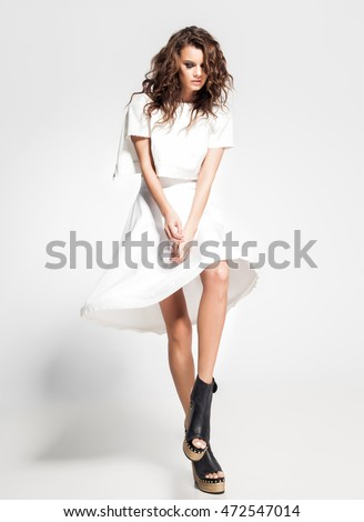 full body of beautiful woman model posing in white dress in the studio