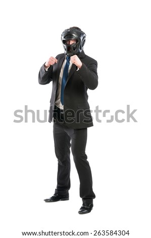 Full body of business man on guard wearing boxing helmet - stock photo
