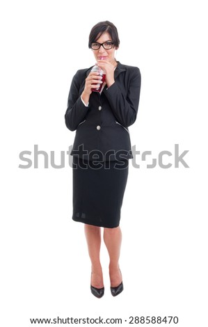 Full body of business woman drinking healthy juice from a cup to go - stock photo