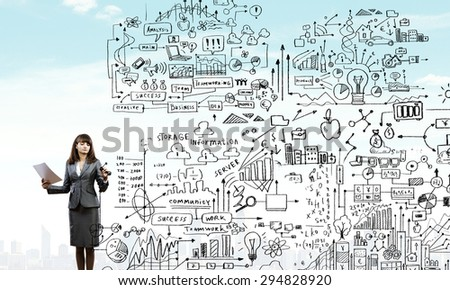 Full body of businesswoman drawing sketches of business strategy