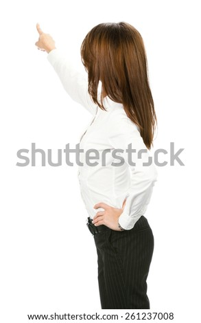 Full body of businesswoman pointing at something in her back, isolated against white background - stock photo