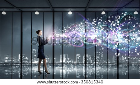 Full body of businesswoman with tablet pc against high tech background