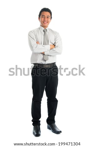 Full body of handsome Asian young male in casual business attire, smiling confidently with arms crossed, standing isolated on white background. - stock photo