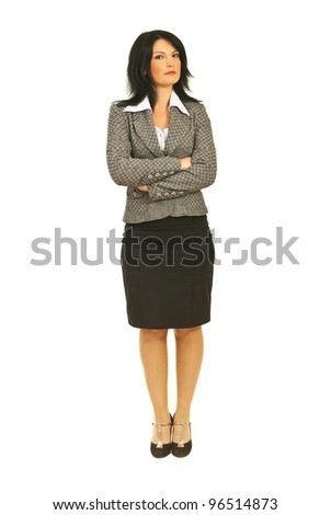 Full body of serious attractive business woman with attitude standing straight with arms folded isolated on white background - stock photo