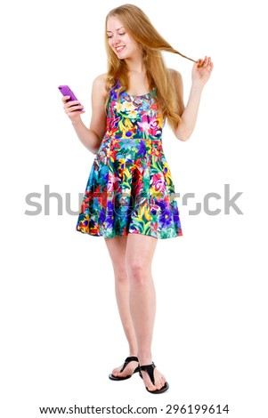 Full body of smile young teenager girl with long blonde hair in mix color dress speak by cell mobile phone, isolated on a white background, Positive human emotions - stock photo