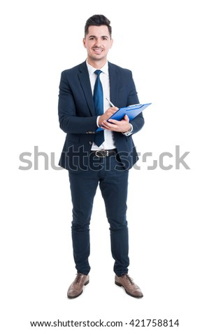 Full body of smiling businessman holding blue clipboard and writing something isolated on white background - stock photo