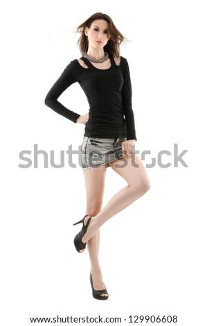 full body of young woman posing in studio - stock photo