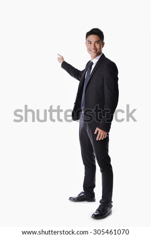 full body picture of a happy business man presenting something on a white background - stock photo