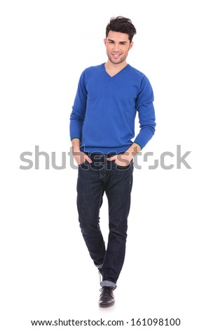 full body picture of a relaxed casual man with hands in pockets on white background - stock photo