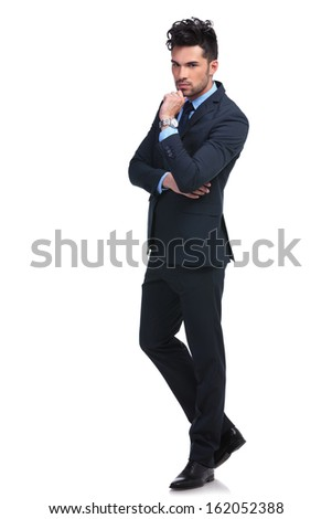 full body picture of a serious pensive business man on white background - stock photo