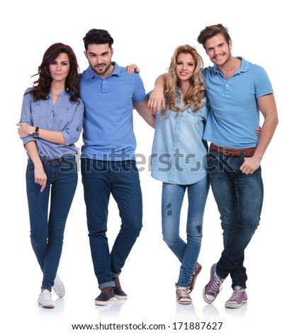 full body picture of a small group of casual young happy people standing together on white background