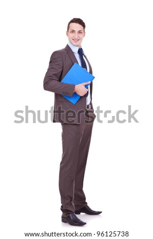 full body picture of a young business man with clipboard in his hand and smiling on white background