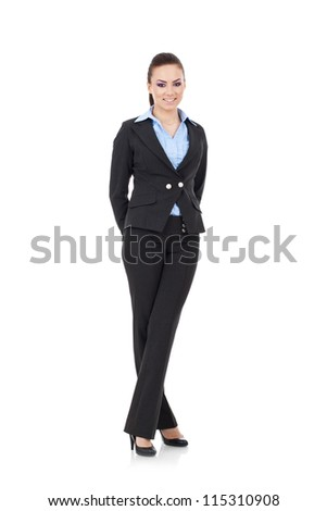 full body picture of an amazing young business woman standing with legs crossed and hands behind her, all while smiling at the camera. isolated on white