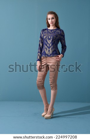 Full body picture of casual young woman posing on light background