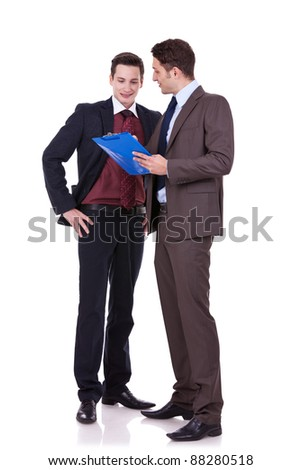 full body picture of two young men discussing on white background - stock photo