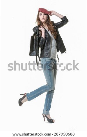 Full body Portrait of a beautiful young woman in jeans with bag posing - stock photo