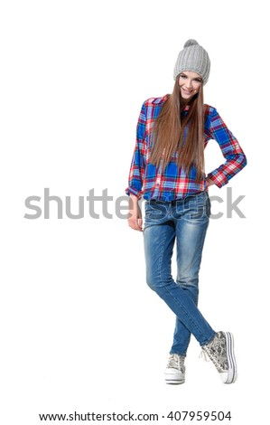 Full body Portrait of a beautiful young woman posing in studio - stock photo