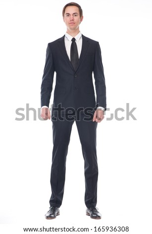 Full body portrait of a businessman in black suit standing on isolated white background - stock photo