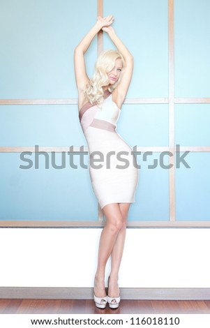 full-body portrait of a gorgeous blond - stock photo