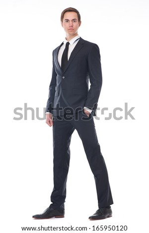 Full body portrait of a handsome young businessman in black suit isolated on white background
