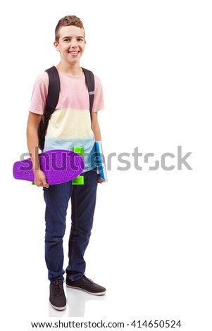 Full body Portrait of a school boy holding a skateboard and notebooks, isolated on white  - stock photo