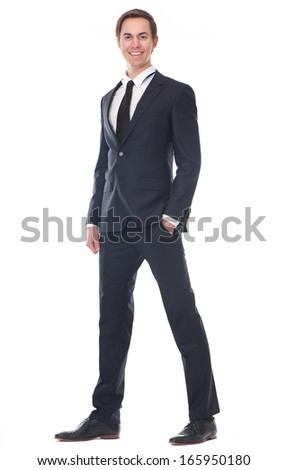 Full body portrait of a smart businessman smiling on isolated white background - stock photo