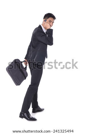 Full body Portrait of a successful young business man carrying a suitcase , - stock photo