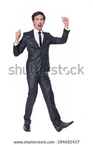 Full body Portrait of a successful young businessman with his hands raised