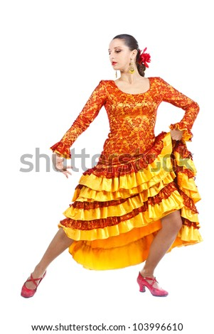 Full-body portrait of a woman flamenco dancer wearing orange and yellow dress, looking down - isolated on white