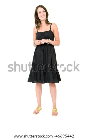 Full body portrait of a young brunette woman in a black summer dress, smiling, unforced - stock photo