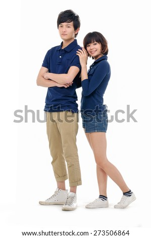 Full body portrait of couple the side standing posing  - stock photo