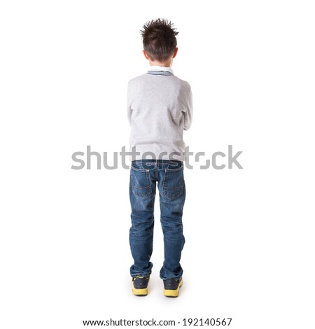 Full body portrait of eight year kid from behind against white background.