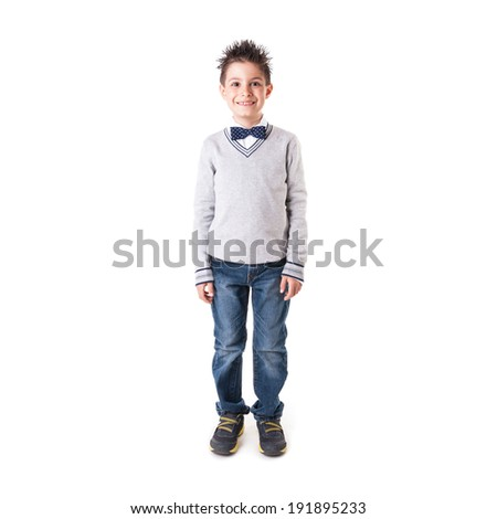 Full body portrait of eight year kid wearing papillon against white background.