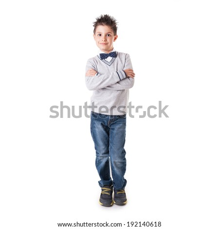 Full body portrait of eight year kid with crossed arms wearing papillon against white background.