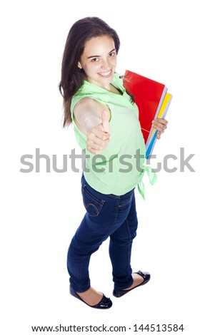 Full body portrait of female student giving thumbs up, isolated on white - stock photo