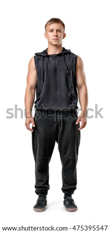 Full body portrait of handsome muscled young man, isolated on white background. Self improvement. Healthy lifestyle. Fitness, sport, bodybuilding, workout. Wellness and beauty.