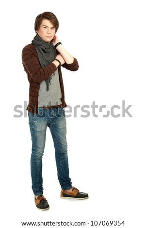 Full-body portrait of handsome young man smiling at camera isolated on white background