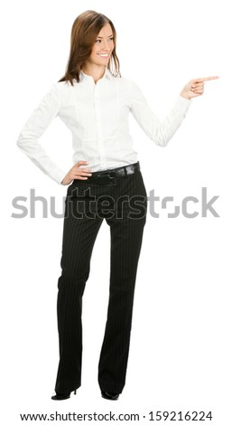 Full body portrait of happy smiling beautiful young cheerful business woman showing something, isolated over white background - stock photo