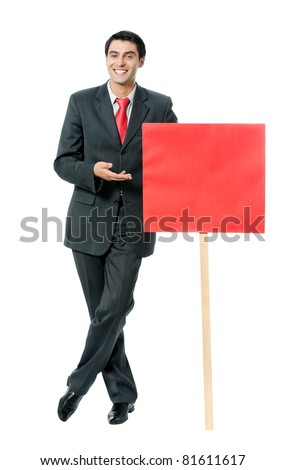 Full body portrait of happy smiling businessman showing red signboard, isolated on white background - stock photo