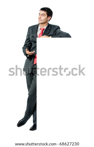 Full body portrait of happy smiling businessman with signboard, isolated on white background