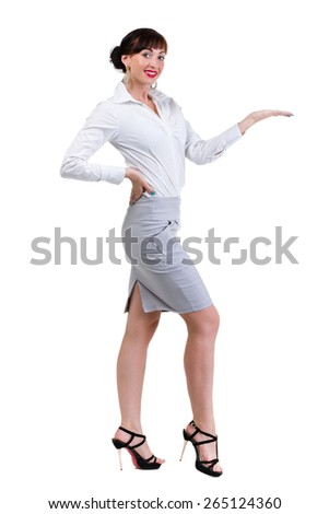 Full body portrait of happy smiling young beautiful business woman showing something or copyspase for product or sign text, isolated over white background - stock photo