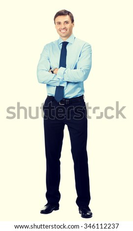 Full body portrait of happy smiling young business man