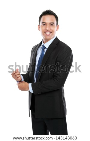 Full body portrait of happy smiling young businessman isolated on white background - stock photo
