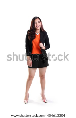 Full body portrait of happy young Asian business woman looking up and smiling, isolated on white background - stock photo