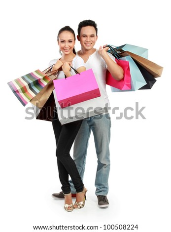 full body portrait of Romantic young couple shopping isolated on white background - stock photo