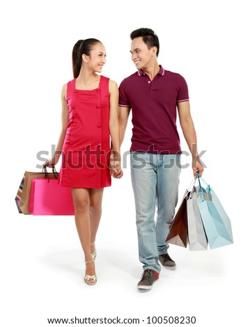 full body portrait of Romantic young couple shopping isolated on white background