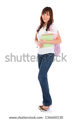 Full body portrait of smiling Asian female young adult student standing isolated on white background - stock photo